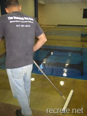 Doug applying the floor finish to a stained concrete project